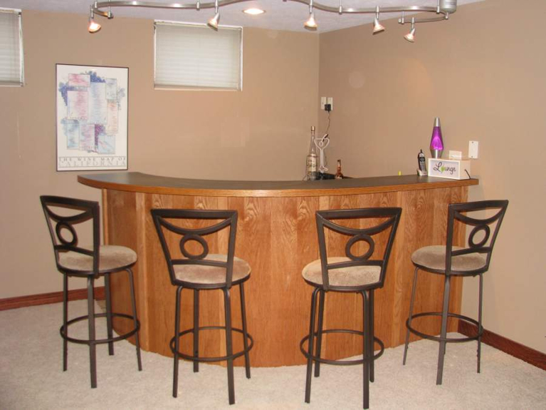 Curved veneered bar Lincoln East hight School
