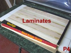 Sled for vacuum pressing laminates with wedge to apply side pressure.
