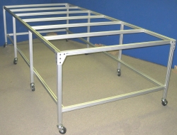 Structural aluminum table on caster for vacuum frame press