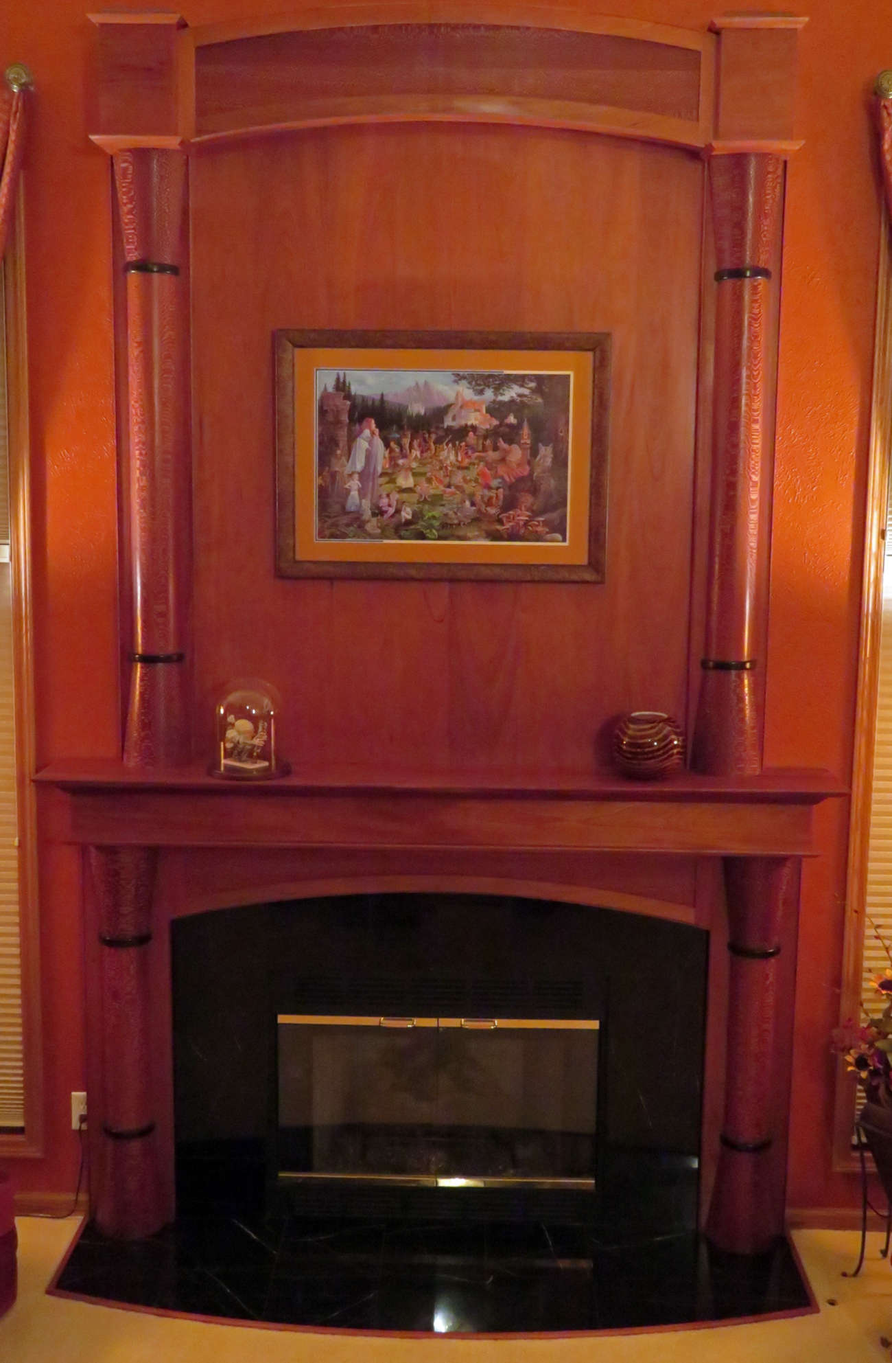 custom mantel designed with customer.  Woods used are:Honduras Mahogany,, Leopard Wand and Wenge.  This highlights the entire room.